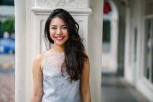 young woman smiling after cosmetic dentistry services