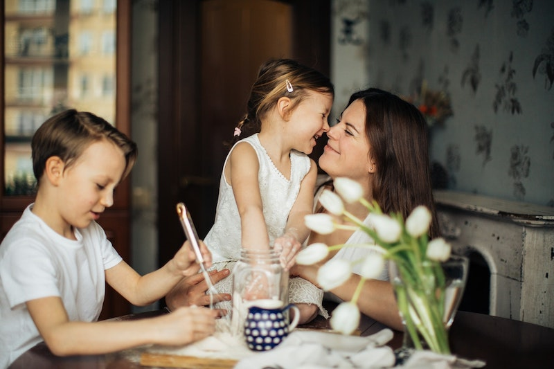 Mother laughing with her son and daughter.