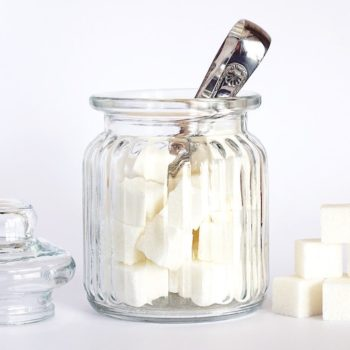 Glass jar containing cubes of Xylitol