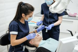 Person in dental chair during examination.