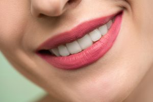 Smile with straight white teeth. Straightening your teeth with Invisalign can bring quite a few benefits.